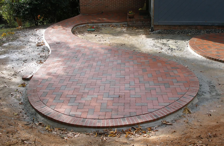 Round Patio think outside the square: curved and round patios and walkways