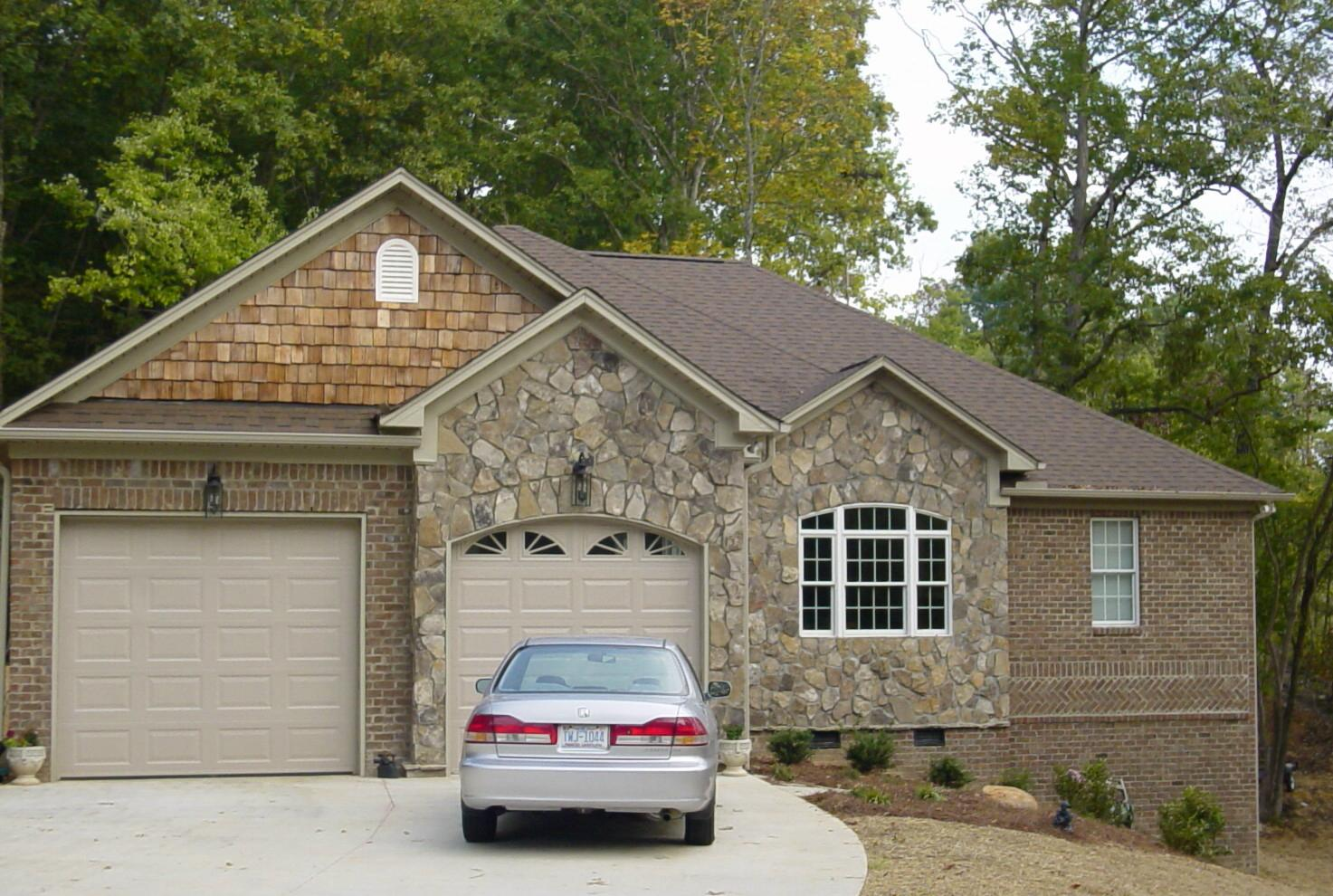 Mixed media using brick and stone in home facades pine for Houses with stone accents